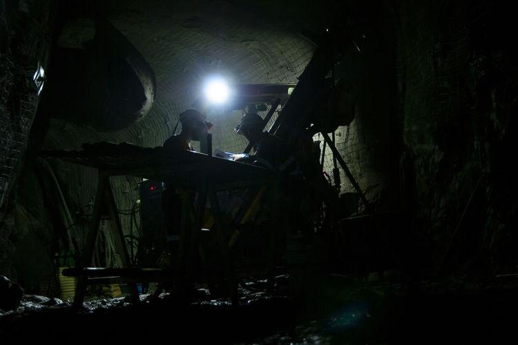 Silhouette man working at night
