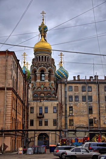 The Splendors and Miseries of Saint-Petersburg Architectural Feature Architecture Cars Cathedral Church Cloud Dome Gold Graffiiti Group Of Houses Religion The Savior On Blood Window Wires In The Sky Yard