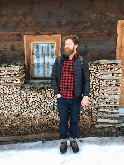Full Length Of Man Standing On Snow Against House
