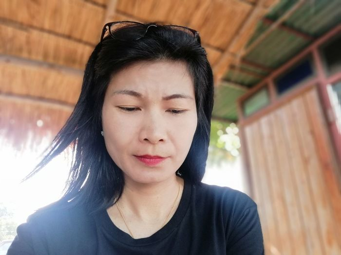 JiraOn🌏 EyeEm Selects Young Women Portrait Headshot Smiling Women Front View Beautiful Woman Enjoyment Black Hair Eyes Closed  Thoughtful Day Dreaming Thinking Hope - Concept Wishing Shore Tranquil Scene Streaming Pensive Calm