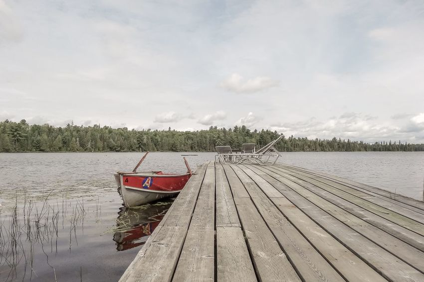 In Algonquin. Water Nautical Vessel Transportation Mode Of Transportation Sky Cloud - Sky Nature Moored Day No People Tranquility Scenics - Nature Lake Tranquil Scene Beauty In Nature Plant Wood - Material Outdoors Tree Fishing Boat