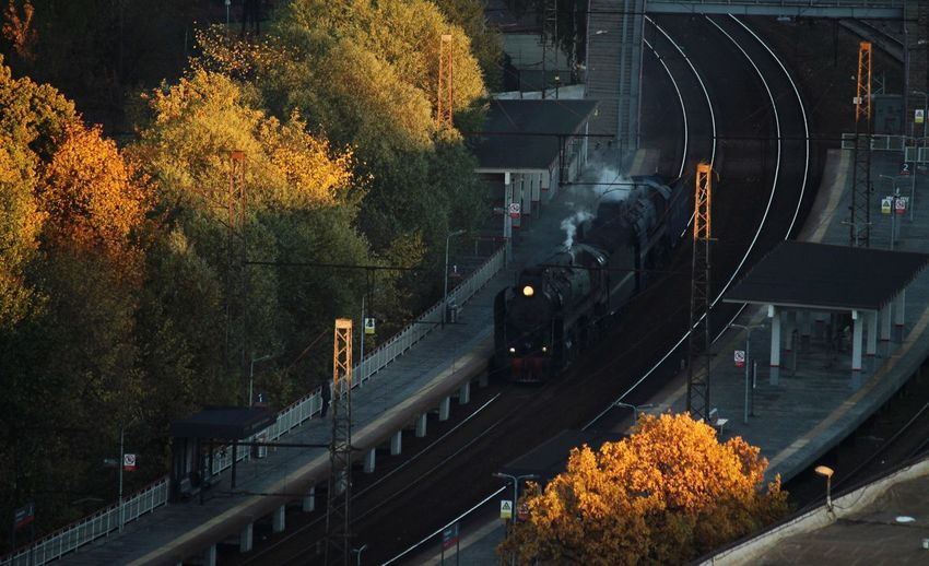 High angle view of train on railroad tracks during autumn