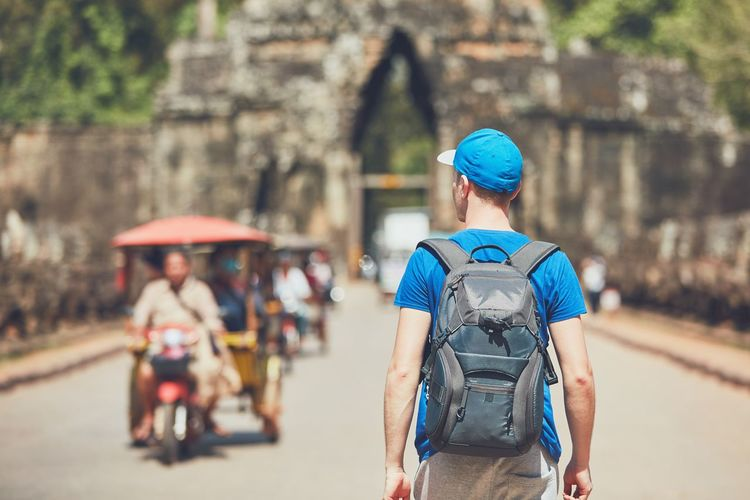 Rear View Of Backpacker On Road