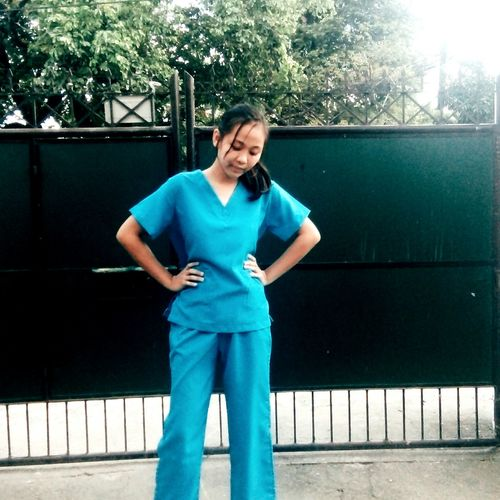student wearing blue scrub suit Scrub Suit Blue Scrub Suit Philippines School St. Nicholas Academy School Life  Immersion IG Post Front View One Person Only Women One Woman Only Adults Only Standing People Adult Outdoors Casual Clothing Day Holding Sport Full Length One Young Woman Only Sports Clothing Young Adult Smiling Women Athlete