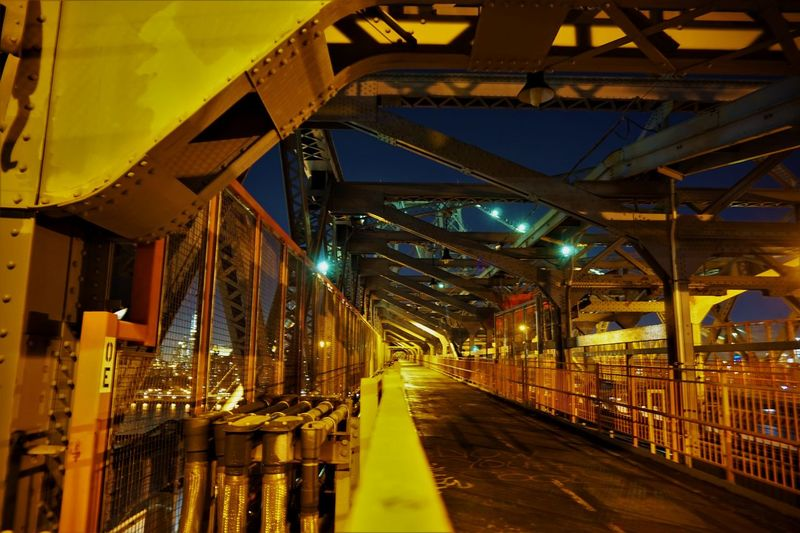 Illuminated bridge in city at night
