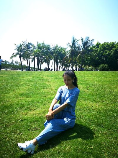 Plant One Person Grass Sitting Full Length Casual Clothing Field