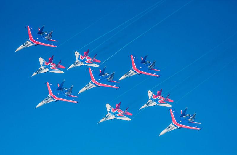View of kites flying against blue sky