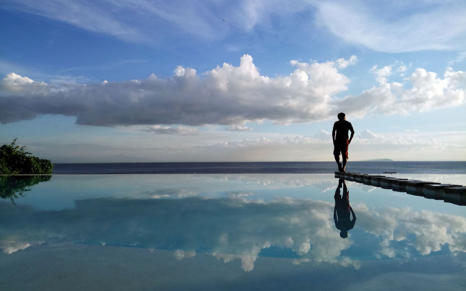 Beauty In Nature Cloud - Sky Full Length Horizon Over Water Live For The Story Men Nature One Person Outdoors People Real People Reflection Scenics Sea Silhouette Sky Tranquil Scene Tranquility Water