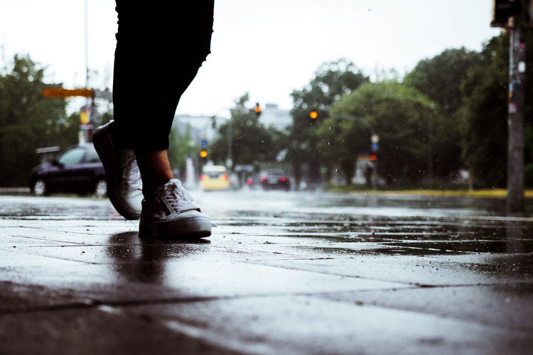 Low Section Of Woman Walking In Rain