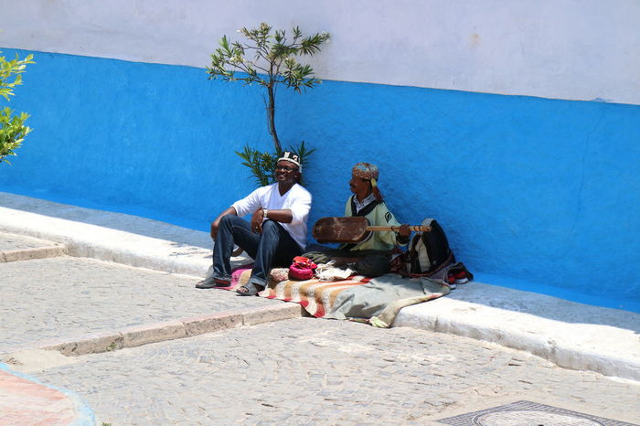 Canon Eos M3 Medina Morocco Playing Music Rabat Real People Singing Travel Travel Photography First Eyeem Photo Streetphotography Street Photography Blue Wall Happiness Happy People The Street Photographer - 2016 EyeEm Awards The Portraitist - 2016 EyeEm Awards Feel The Journey Colour Of Life People And Places