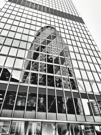 Low Angle View Day Building Exterior No People Outdoors Skyscraper Architecture Built Structure Sky Close-up London British Architecture Lookingup Gherkin Tower Monochrome Mobilephoto Motography Snapseed Motog5 City Life Cityoflondon NormanFoster Black And White Reflection Reflected In Windows