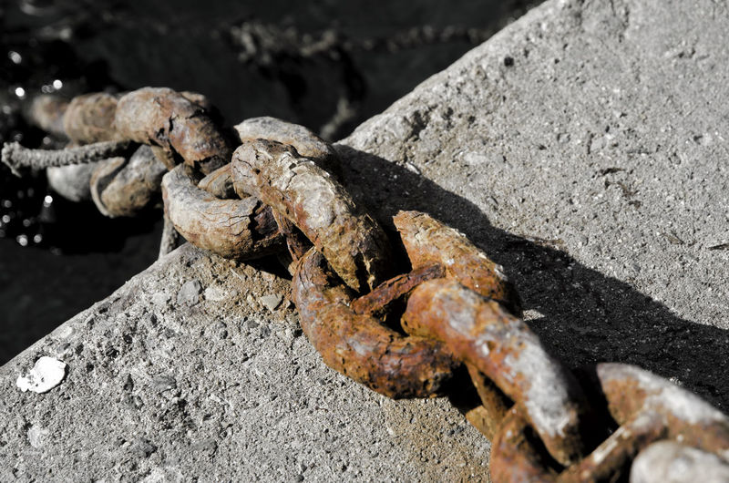 Rusty chain. Art Art And Craft Brown Chain Close-up Color Day Dirty Focus On Foreground No People Old Outdoors Part Of Rear View Rusty Selective Focus Strength Sunny Water