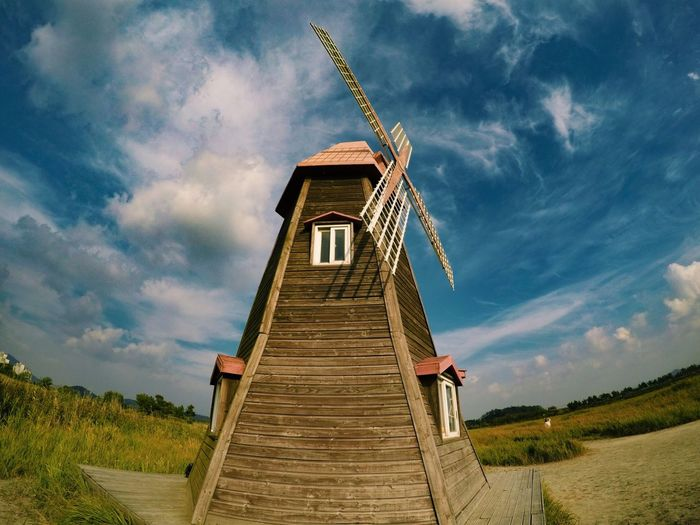 Gopro Sky Cloud - Sky Architecture Built Structure Outdoors Day Low Angle View No People Field Wood - Material Rural Scene Building Exterior Nature Beauty In Nature Windmill Grass
