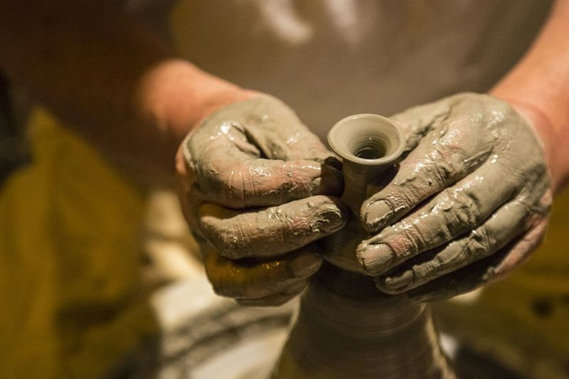 Cropped Image Of Potter Making Pottery In Workshop