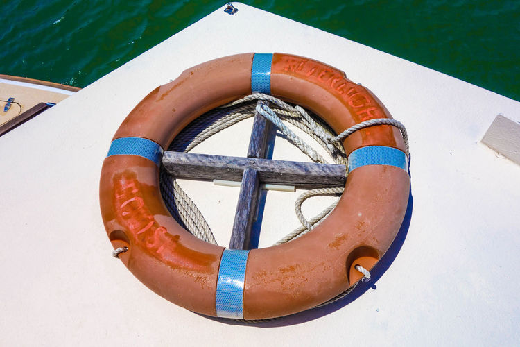 High angle view of life belt on boat