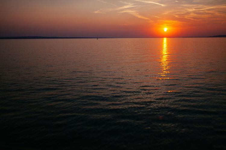 Awe Beauty In Nature Calm Cloud Idyllic Majestic Moody Sky Nature Non-urban Scene Ocean Orange Color Reflection Scenics Sea Seascape Sky Sun Sunbeam Sunset TeamCanon Tranquil Scene Tranquility Vibrant Color Water Waterfront
