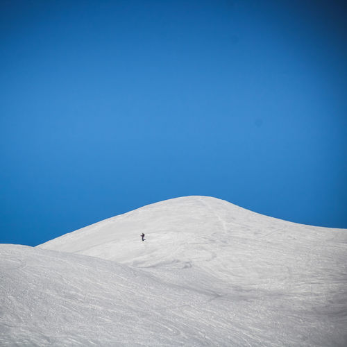 Snow Winter Cold Temperature Blue Winter Sport Mountain Sport Sky One Person Unrecognizable Person Day Environment Scenics - Nature Beauty In Nature Adventure Nature Clear Sky Travel Leisure Activity Snowcapped Mountain Oisans Alone Lost in the Landscape Alps French Alps Top Of The Mountains Hiking Skiing Ski Winter Sport The Minimalist - 2019 EyeEm Awards The Great Outdoors - 2019 EyeEm Awards