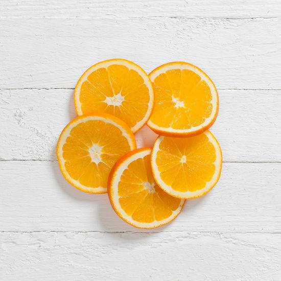 A circle of fresh orange slices Circle Orange Citrus Fruit Cross Section Day Food Food And Drink Freshness Fruit Healthy Eating Indoors  No People Orange - Fruit SLICE Studio Shot Table White Background Wood - Material