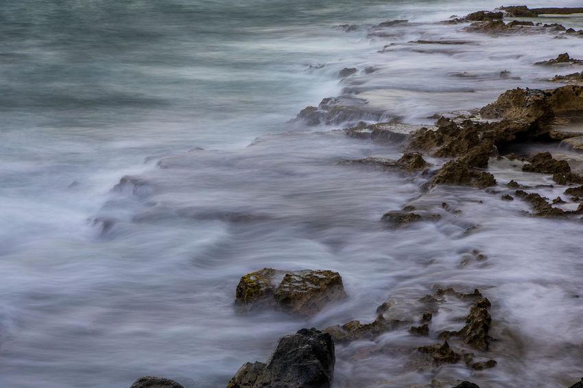 Long exposure of surf on rocks Black Black & White Black And White Black&white California Caribbean Coast Coastline Condado, PR Long Exposure Ocean Ocean View Puerto Rico Rocks San Juan PR Sea Serenity Smooth Surf
