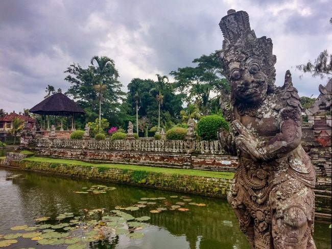 Ancient Civilization Architecture Bali Clouds And Sky Cloudy Exploring Famous Place Garden Hindu Hindu Temple Landmark Lotus Overcast Place Of Worship Pond Religion Religious Architecture Statue Temple Tourist Tourist Attraction  Traveling Trees Water Water Reflections