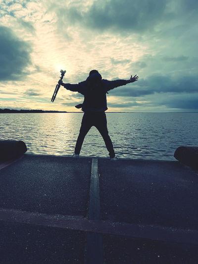 Full length of man standing on sea against sky