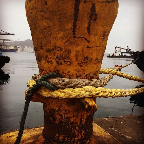 Cast off... Rope Cleat Moored Harbor Nautical Vessel Boat Rusty Travel Photography Live For The Story The Great Outdoors - 2017 EyeEm Awards Water Waterfront Mooring Post Seaside Letting Go Freedom