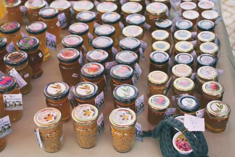 High Angle View Of Honey Jars For Sale At Street Market Stall
