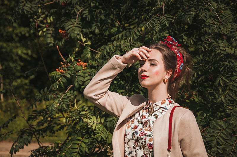 EyeEm Selects Only Women One Woman Only One Person Beautiful Woman Tree People Fashion Retro Styled Beauty Headshot Old-fashioned One Young Woman Only Young Women Outdoors Full Frame Nature Females Grass Models No Filter Women Beautiful People Fashion Brown Hair Fashion Stories