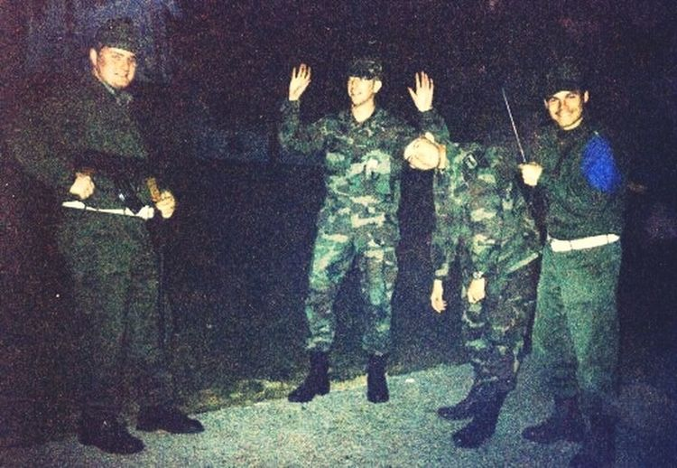 My buddy Tj and I posing with some Hungarian soldiers; I asked them to appear like they are capturing us. circa 1996. IFOR Taszar Citys Of Hungary