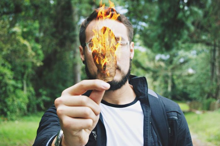 Fire Only Men Human Body Part Human Hand Portrait Forest Bizarre Front View Headshot People Human Face Day Nature Men Outdoors One Man Only Adults Only Adult Mid Adult One Person Young Adult