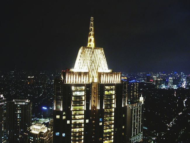 the signature... 252 mtr highrise luxury apartment 7th tallest building of Jakarta EyeEm Best Shots EyeEmNewHere EyeEm Selects Dronephotography Midrone Aerial View Lowlight Lowlightphotography The Graphic City Night Architecture Illuminated Built Structure Travel Destinations Building Exterior Dome No People Sky HUAWEI Photo Award: After Dark