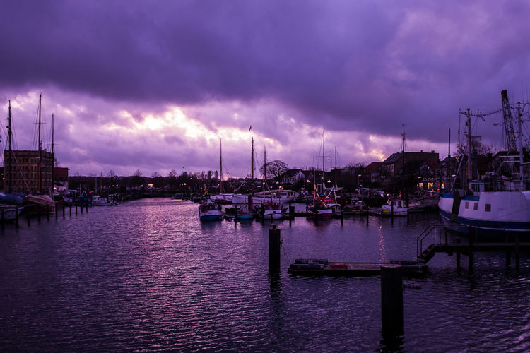 Boat Boats Cloud - Sky Commercial Dock Dock Dramatic Sky Evening Light Harbor Mast Moored Nature Nautical Vessel No People Outdoors Pier Purple Sky Quay Sailboat Sea Sky Storm Cloud Sunset Thunderstorm Water Yacht