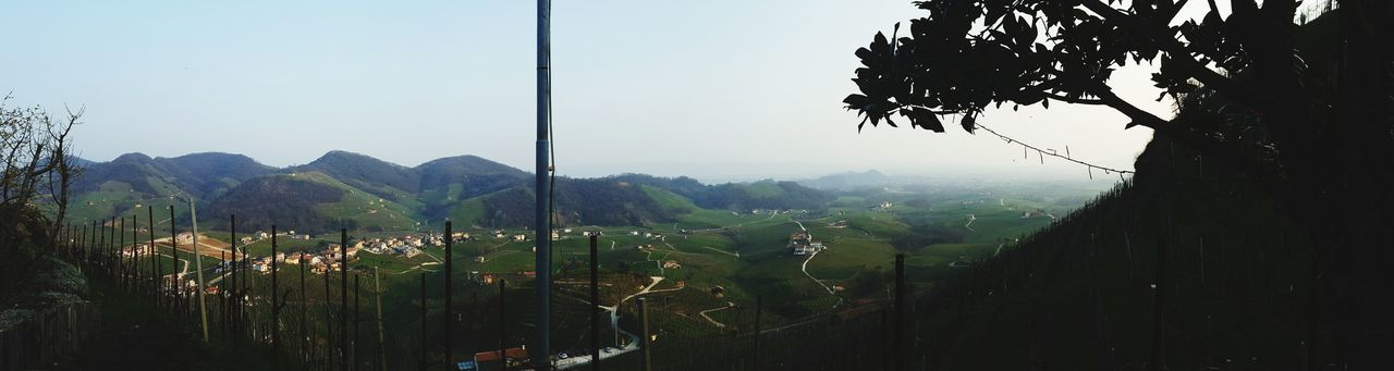 Scenic view of village down valley against clear sky