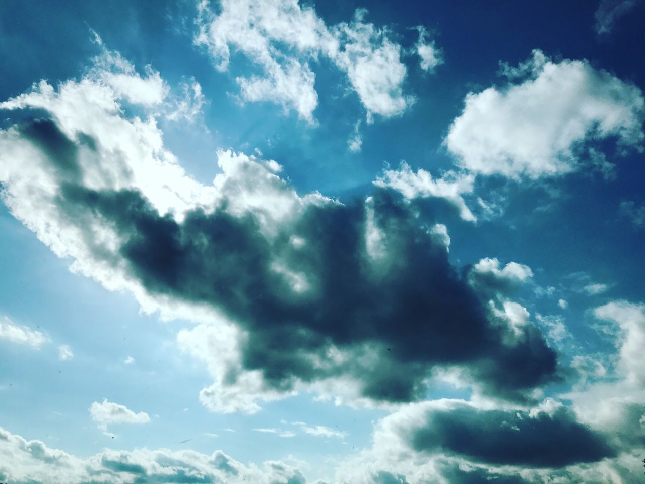 sky, beauty in nature, cloud - sky, nature, low angle view, backgrounds, sky only, scenics, cloudscape, sunbeam, weather, day, outdoors, full frame, no people, blue, tranquility, sunlight