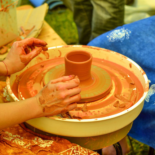 Cropped Image Of Hands Making Pottery