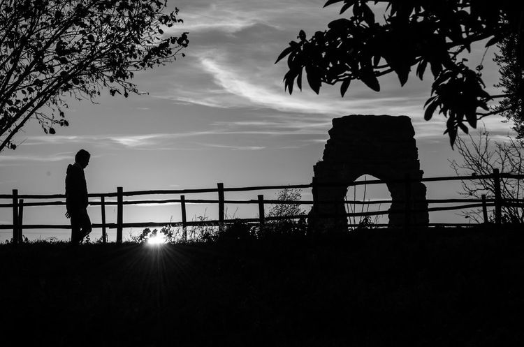 Rome Beauty In Nature Blackandwhite Day Full Length Leisure Activity Men Nature One Person Outdoors People Real People Roman Acqueduct Silhouette Sky Sun Sunlight Sunset Tree Sunrise Silhouette Sunrise N Sunsets Worldwide  Sunrise And Clouds Sunrise - Dawn Silouette & Sky Silhouette_collection Black And White Friday Go Higher Visual Creativity The Street Photographer - 2018 EyeEm Awards The Great Outdoors - 2018 EyeEm Awards Capture Tomorrow