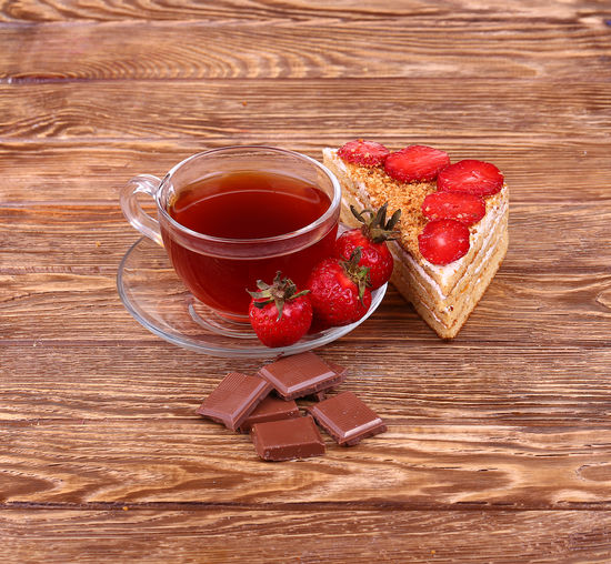 Red wine and tea on table