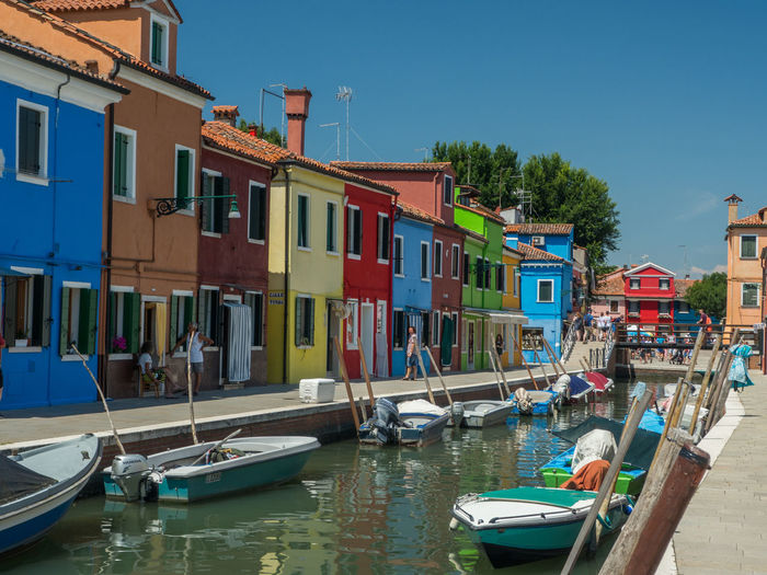 Architecture Building Building Exterior Built Structure Canal City Colorful Day House Mode Of Transportation Moored Multi Colored Nature Nautical Vessel No People Outdoors Reflection Residential District Row House Rowboat Sky Transportation Water Wooden Post