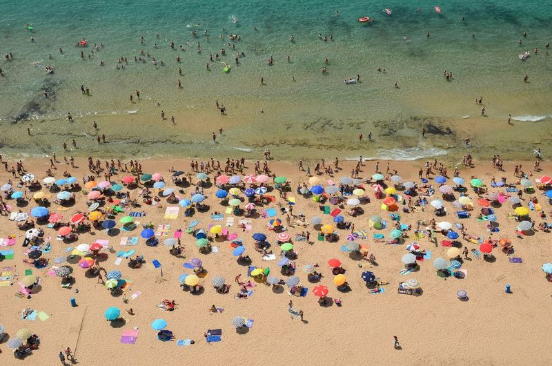 Elevated View Of Crowded Beach With Multicolored Umbrellas