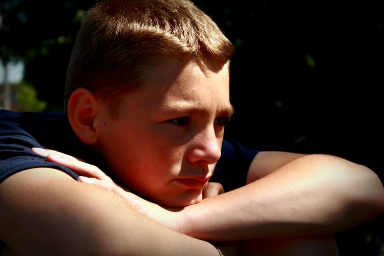 Close-Up Of Thoughtful Teenage Boy