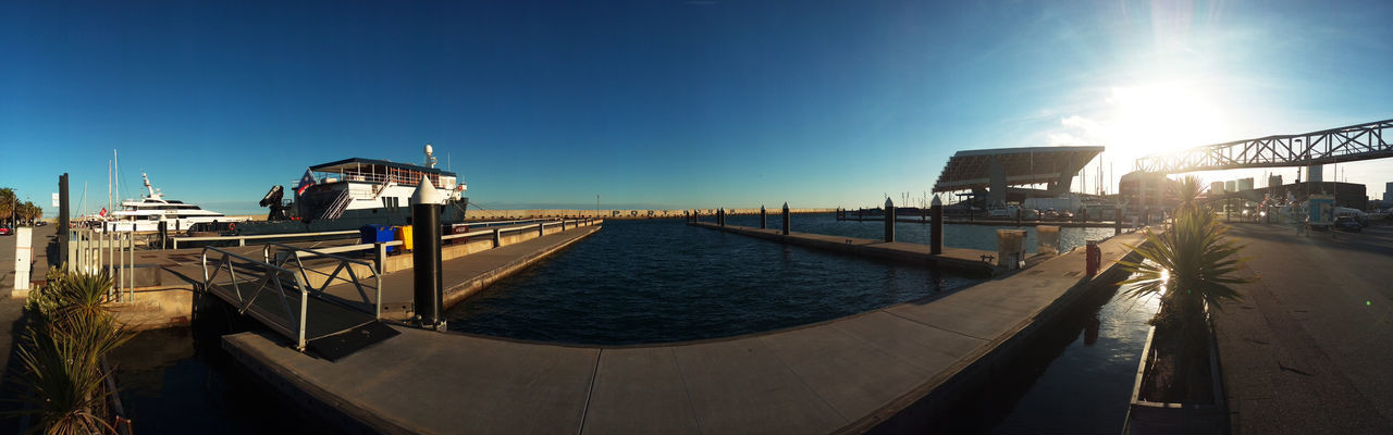 Panoramic Shot Of Harbor Against Clear Blue Sky