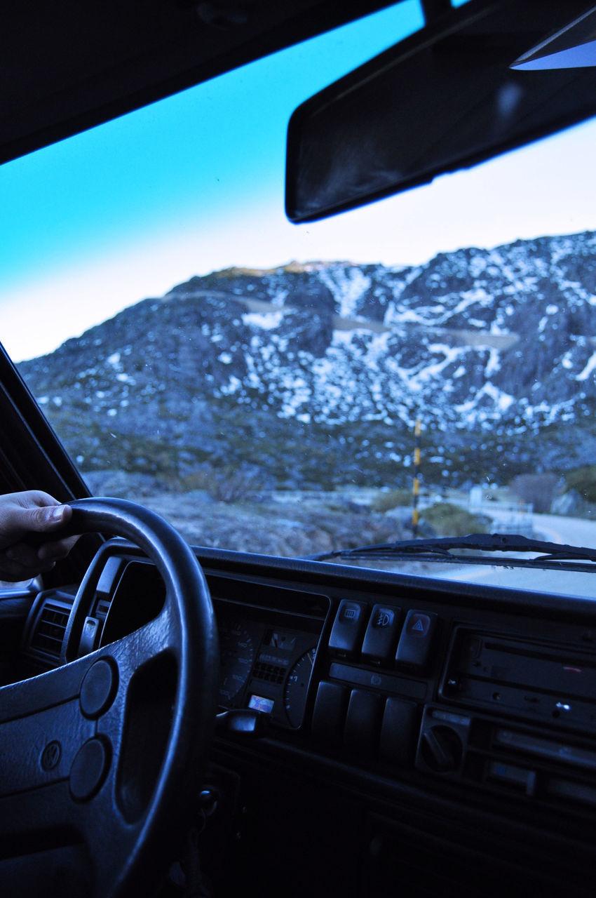 TILT IMAGE OF CAR ON MOUNTAIN