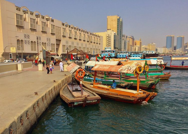 Before Sunset Al Ras Dubai Water Transportation Water Boat Abra Noon Architecture Building Exterior Built Structure Large Group Of People Real People City Clear Sky Water Outdoors Day People Sky An Eye For Travel