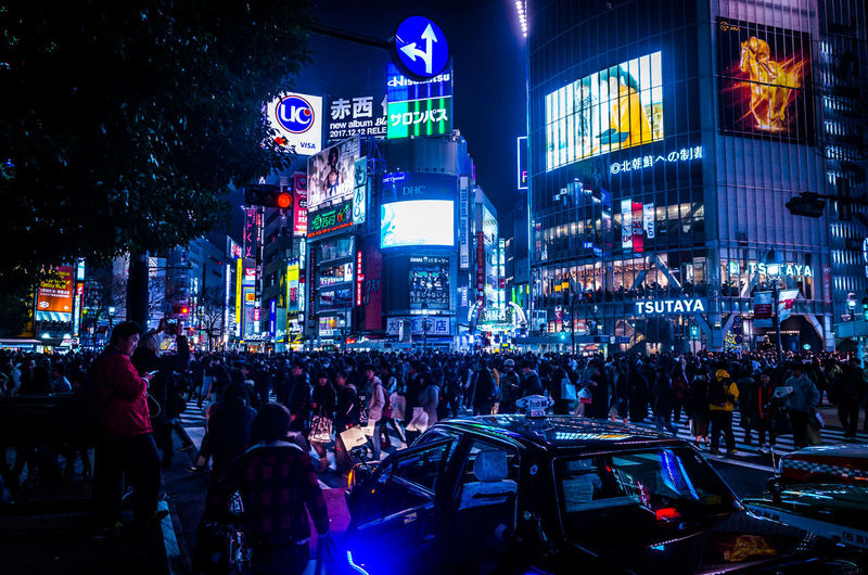 Crowd in city at night