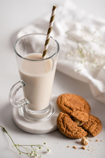 Close-up of coffee and cookies on table