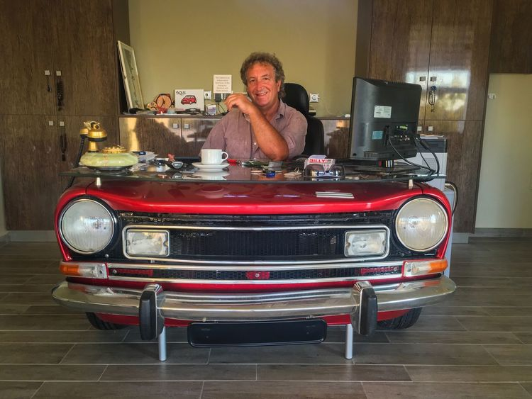 My work place! Front View Indoors  Car Car Lover Workplace People And Places Man Office Office Life Auto Autoportrait Strange Desk Art Desk Smile Sitting Sitting Alone Headlight Cars Table In Front Of Car Rental One Person Oldtimer Design