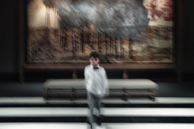 Blurred motion of man walking through window