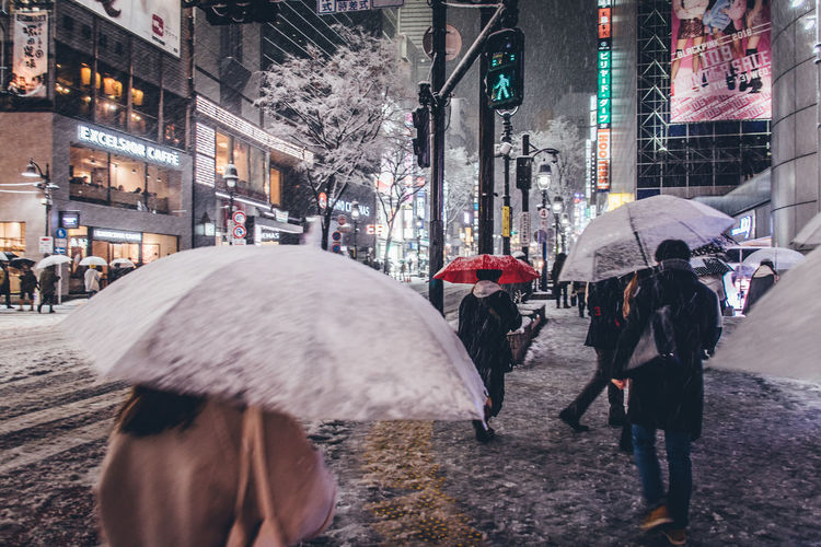 Jan.22 2018 Snowy day Shibuyascapes Color Redefining Red Japan Lovers Japan Shibuya Tokyo City City Life Cold Temperature Illuminated Large Group Of People Lifestyles Men Night Outdoors Rain Rainy Season Real People Road Snow Snowing Snowy Snowy Day Street Walking Warm Clothing Weather Winter Women Stories From The City The Street Photographer - 2018 EyeEm Awards HUAWEI Photo Award: After Dark