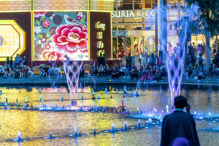 Sunset at Petronas Twin Towers KLCC, Kuala Lumpur Illuminated Water Real People Group Of People Architecture Large Group Of People Adult Women Built Structure Reflection Leisure Activity Crowd Men City Motion Building Exterior Travel Lifestyles