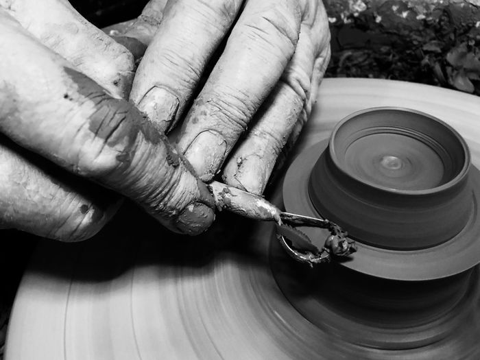 Cropped hands of person making pottery